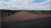 NU0038 : Barmoor Wind Farm access road by Graham Robson