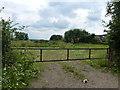 TL4775 : Farm entrance near Haddenham by Richard Humphrey