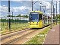 SJ8097 : Metrolink Tram, The Quays by David Dixon