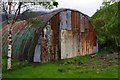 NG8409 : Rusty shed by Ian Taylor