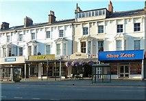 SH7882 : Food and Footwear on Mostyn Street by Gerald England