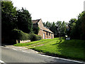 TM3192 : Hedenham Village Hall & sign by Adrian Cable