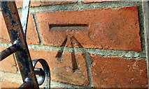 ST6076 : Benchmark on #48 Elmore Road by Roger Templeman