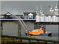 TV6198 : RNLI Lifeboat fire fighting at Eastbourne Pier by PAUL FARMER