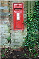 SU6181 : Benchmark below wall letter box, Battle Road by Roger Templeman
