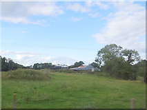 N3723 : Farm buildings and field by Ian Paterson
