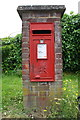 SU7072 : Pillar box with benchmark, St Saviour's Road by Roger Templeman