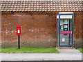 SK6869 : Kirton postbox ref NG22 187 and telephone kiosk by Alan Murray-Rust