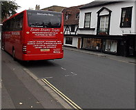 SU1429 : Vivid red tour coach in Salisbury by Jaggery