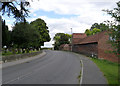 SK7773 : A57 passing Hall Farm by Alan Murray-Rust