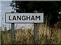 TM0132 : Langham Village Name sign by Adrian Cable