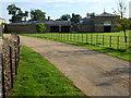 TF8643 : Model Farm near Holkham Hall, Norfolk by Richard Humphrey