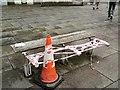 SJ9494 : Cone and broken bench by Gerald England