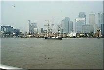 TQ3880 : View of Thalassa passing Canary Wharf #2 by Robert Lamb