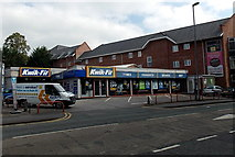 SJ8481 : Kwik-Fit shop and van in Wilmslow by Jaggery