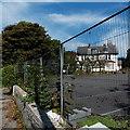 SJ8479 : Fenced-off former County Hotel in Alderley Edge by Jaggery