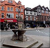 SJ2929 : Stone fountain and market cross in the centre of Oswestry by Jaggery