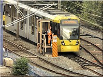 SJ8499 : Metrolink Tram Waiting Outside Victoria Station by David Dixon