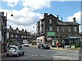 SE1147 : Shops on Leeds Road [the A65], Ilkley by Christine Johnstone