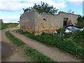 TL4189 : The remains of Folly Farm by Richard Humphrey