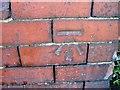 NZ4243 : Ordnance Survey Bench Mark by Alex McGregor
