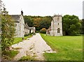 SY6698 : Nether Cerne Manor and All Saints church by Derek Voller