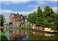 SJ8934 : Canal, school and narrowboat at Stone, Staffordshire by Roger  Kidd