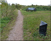 SK5907 : Bench and marker along the towpath by Mat Fascione