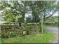 SD6379 : Waymarker next to sheepfold on Fell Foot Road by Raymond Knapman
