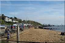 TQ8485 : View of the coastal path and the c2c railway line from the jetty by the beach by Robert Lamb