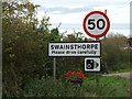TG2100 : Swainsthorpe Village Name sign by Adrian Cable