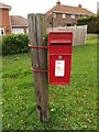 TG2100 : Church Close/Station Road Postbox by Adrian Cable