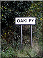 TM1777 : Oakley Village Name sign on the B1118 by Adrian Cable