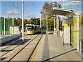 SJ8089 : Inbound Tram Leaving Moor Road Metrolink Stop by David Dixon