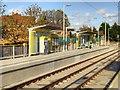 SJ8090 : Northern Moor Metrolink Stop, Inbound Platform by David Dixon