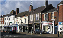 SO9596 : Bilston - Shops on Mount Pleasant - middle section by Dave Bevis