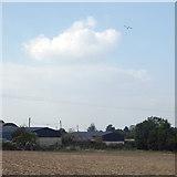 SP2079 : Farm buildings and field below the Birmingham Airport flightpath, Walsal End by Robin Stott