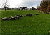 ST3091 : Old tyres embedded in a school field, Malpas, Newport by Jaggery