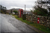 NB9812 : Post box and telephone kiosk at Altandhu by Ian S