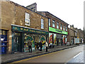 NY7064 : Shops in Westgate by Rose and Trev Clough
