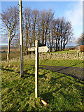 NY5675 : Signpost by New House by Oliver Dixon