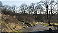 NS4673 : Looking down the track from Kilpatrick Braes and Loch Humphrey by Doug Lee