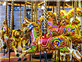TQ2679 : On a carousel by Chris Denny