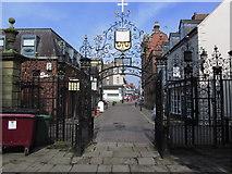 SJ3350 : Ornate gateway to St Giles Church Wrexham, & Church St. by Colin Park