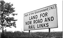 "J3475 : ""Land for new road and rail links"" sign, York Street, Belfast (July 1983) by Albert Bridge"