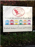 TM3869 : Yoxford Arts & Crafts Beach Huts sign at Yoxwood Antiques Centre by Adrian Cable