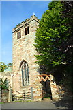 NY6820 : West face of the tower of St Lawrence's Church by Roger Templeman