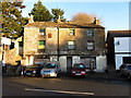 NY7146 : Old garage building, Townhead, Alston by Andrew Curtis