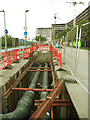 TQ4079 : District heating pipes by Stephen Craven