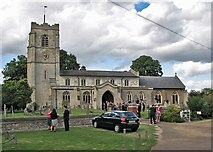 TL3949 : Barrington: All Saints' Church and wedding guests by John Sutton